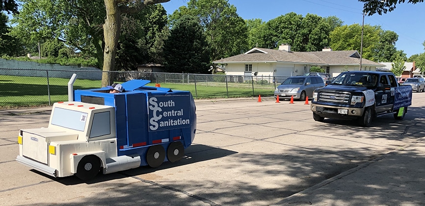 South Central Sanitation garbage truck float in parade